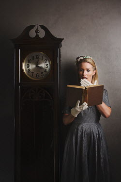 Robin Macmillan WOMAN WITH BOOK BY OLD CLOCK Women