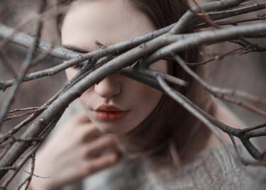 Kirill Sakryukin YOUNG WOMAN BEHIND WINTER TREE BRANCHES Women