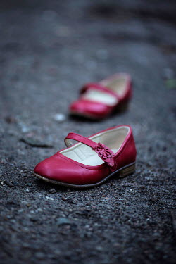 Karina Simonsen LITTLE GIRLS RED SHOES ON PATH Miscellaneous Objects