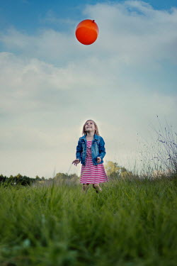 Karina Simonsen LITTLE GIRL WITH BALLOON IN FIELD Children