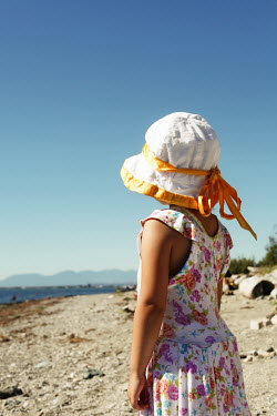 Lisa Howarth LITTLE GIRL IN SUN HAT ON BEACH Children