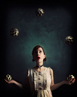 Elle Moss YOUNG BRUNETTE WOMAN JUGGLING BALLS Women
