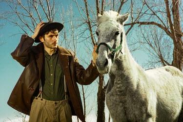 Lidia Vives Rodrigo MAN IN HAT WITH HORSE BESIDE TREE Men