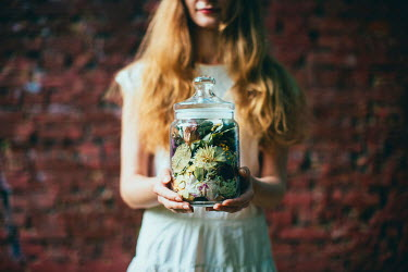 Dasha Pears YOUNG WOMAN HOLDING JAR OF FLOWERS Women