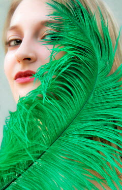 Ilona Wellmann YOUNG WOMAN WITH GREEN FEATHER Women