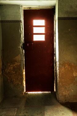 Stephen Mulcahey light behind prison cell door Interiors/Rooms