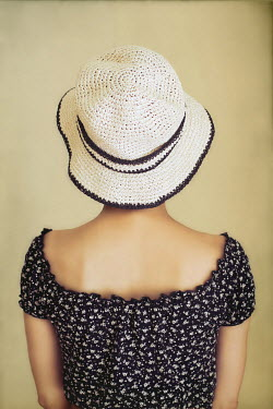 Irene Lamprakou YOUNG RETRO WOMAN IN WHITE SUN HAT Women