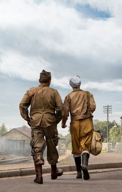 Stephen Mulcahey WW2 wartime couple walking towards railway station Couples