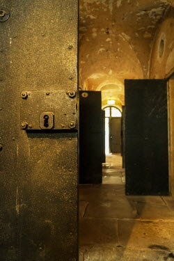 Stephen Mulcahey Prison cell doors open in a jail Interiors/Rooms