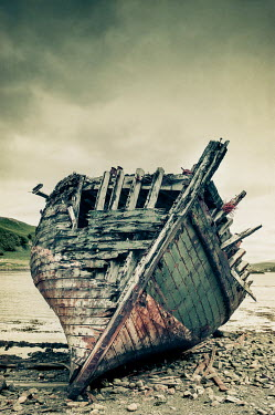 John Cooper wrecked wooden boat on beach Boats
