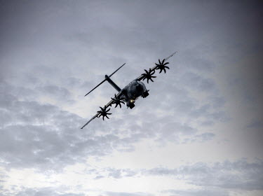 CollaborationJS military aeroplane flying through clouds Miscellaneous Transport