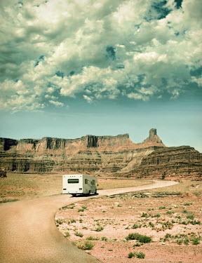 Jill Battaglia RV van driving on road past mountains Miscellaneous Transport