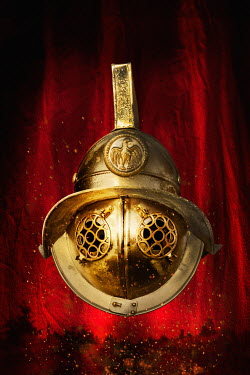 Stephen Mulcahey GOLDEN ROMAN HELMET ON RED BACKGROUND Miscellaneous Objects