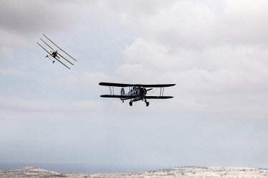 CollaborationJS two WW1 aeroplanes flying over cliffs Miscellaneous Transport
