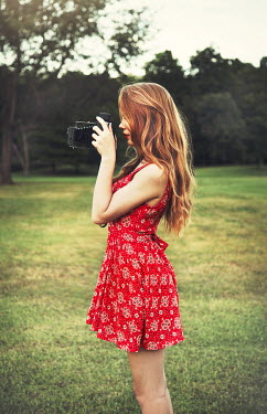 Buffy Cooper YOUNG WOMAN WITH CAMERA IN COUNTRYSIDE Women