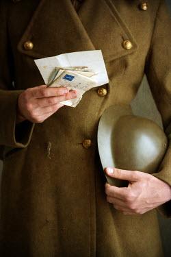 Lee Avison world war one soldier holding helmet and letters Men