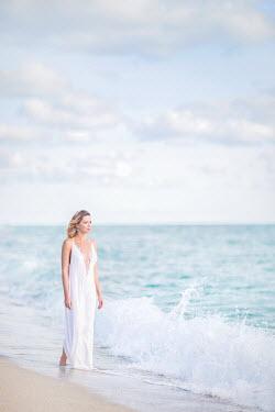 Evelina Kremsdorf YOUNG BLONDE WOMAN WALKING ON SANDY BEACH Women