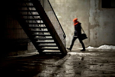 Hanna Seweryn MAN WALKING BY CITY STEPS IN WINTER Men