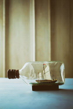 Sandra Cunningham Small ship in a bottle on table Miscellaneous Objects