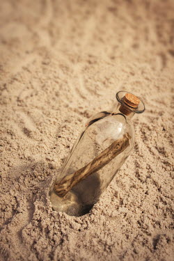Emma Goulder MESSAGE IN A BOTTLE ON SANDY BEACH Miscellaneous Objects