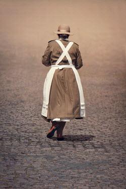 Emma Goulder HISTORICAL NURSE WOMAN ON COBBLED STREET Women