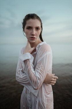 Tatiana Mertsalova YOUNG WOMAN IN WET SHIRT STANDING BY SEA Women
