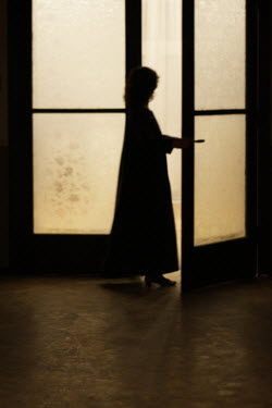 Hanna Seweryn SILHOUETTE OF YOUNG WOMAN OPENING DOOR Women