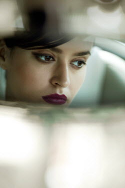 Miguel Sobreira YOUNG WOMAN REFLECTED IN REAR VIEW MIRROR Women