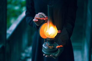 Ebru Sidar HISTORICAL WOMAN CARRYING GAS LAMP AT NIGHT Women