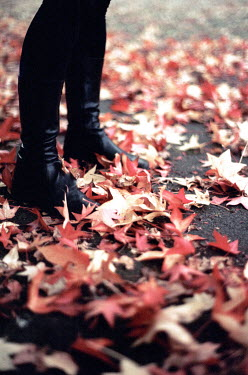 Nicole Wustrack WOMAN IN BOOTS STANDING ON AUTUMN LEAVES Women