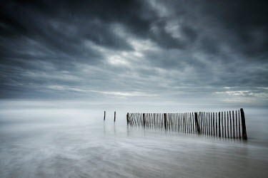 Christophe Dessaigne BROKEN FENCE POSTS IN STORMY SEA Seascapes/Beaches