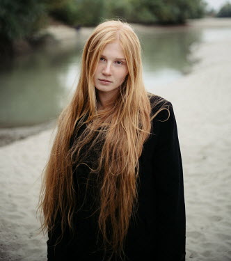 Dmitry Ageev YOUNG WOMAN WITH LONG RED HAIR BY LAKE Women