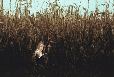 Tijana Moraca YOUNG GIRL WITH TORCH AMONG FARM CROPS Children