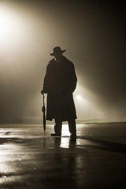 Terry Bidgood SILHOUETTE OF OLD MAN ON STREET AT NIGHT Men