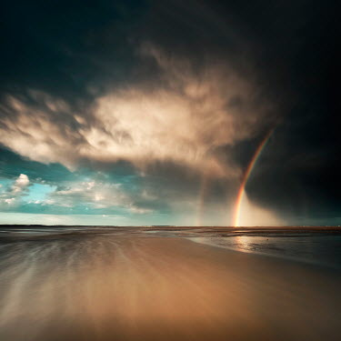 David Keochkerian RAINBOW AND CLOUDS OVER SANDY BEACH Seascapes/Beaches