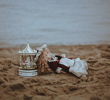 Alina Zhidovinova VINTAGE CAROUSEL TOY AND DOLL ON BEACH Miscellaneous Objects