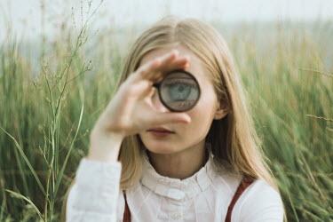 Alina Zhidovinova YOUNG BLONDE WOMAN MAGNIFYING EYE IN COUNTRYSIDE Women