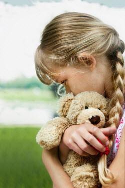 Yolande de Kort LITTLE BLONDE GIRL WITH PLAIT HUGGING TEDDY BEAR Children