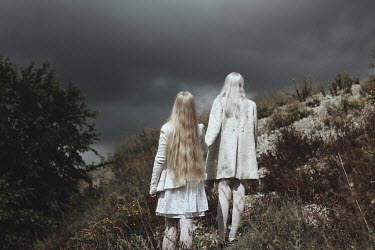 Alina Zhidovinova TWO YOUNG BLONDE WOMEN CLIMBING UP HILLSIDE Groups/Crowds