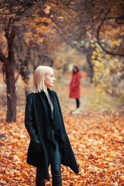 Ildiko Neer two young women walking away in autumn forest Groups/Crowds