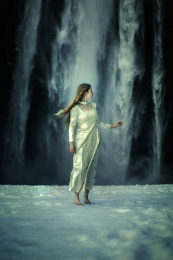 Terrence Drysdale YOUNG VINTAGE WOMAN ON SNOW BY WATERFALL Women