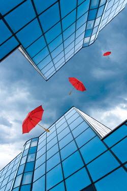 Valentino Sani THREE RED UMBRELLAS FALLING PAST CITY BUILDINGS Miscellaneous Buildings