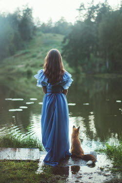 Irina Brana BRUNETTE WOMAN WITH FOX NEAR COUNTRYSIDE RIVER Women