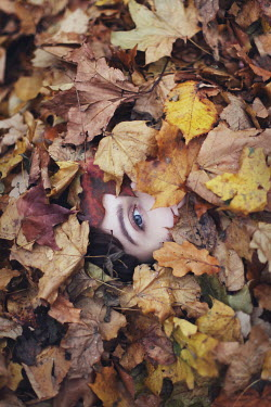 Irina Brana YOUNG WOMAN BURIED UNDER AUTUMN LEAVES Women