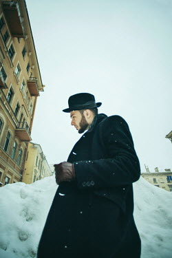 Irina Brana MAN WITH BEARD AND HAT BY SNOW DRIFT IN CITY Men