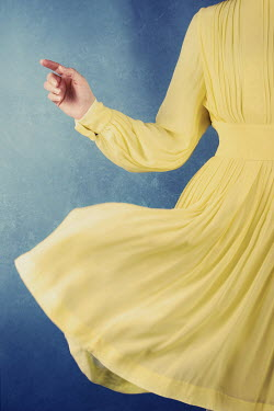 Sara Helwe WOMAN WEARING YELLOW DRESS Women