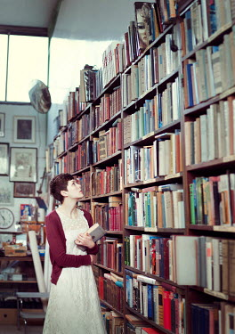 Renee Quost YOUNG BRUNETTE WOMAN IN BOOK SHOP Women