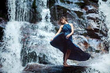 Renee Quost YOUNG WOMAN IN BLUE DRESS BY WATERFALL Women
