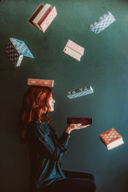 Vanesa Munoz YOUNG WOMAN WITH RED HAIR BELOW FLOATING BOOKS Women