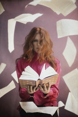Vanesa Munoz YOUNG WOMAN WITH BOOK BELOW FLOATING PAGES Women